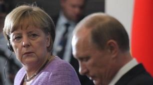 e7487980-a9dd-11e3-a0f0-a5e8aafb61ea_Merkel-and-Putin